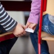 School students passing a chit in the classroom — Stock Photo