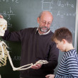 Teacher With Skeleton Teaching Student In Classroom — Stock Photo