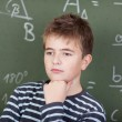 Young schoolboy thinking about something — Stock Photo