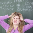 Frustrated Girl With Hands In Hair Against Chalkboard — Stock Photo