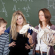Teacher Explaining Dinosaur Skeleton Parts To Students — Stock Photo