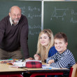Stock Photo: Teacher and students with a skeleton