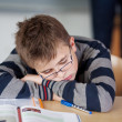 Stock Photo: Boy sleeps during class