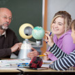 Teacher And Students Looking At Planetarium Model At Desk — Stock Photo #27315161