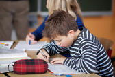 Student is writing — Stock Photo