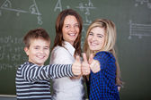 Teacher And Students Showing Thumbsup Gesture Against Blackboard — Stock Photo