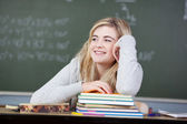 Student Looking Away At Desk In Classroom — Stock Photo