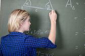 Teenage Girl Writing On Chalkboard — Stock Photo