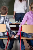 Children Passing Cheat In Examination At Classroom — Stock Photo