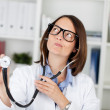 Doctor Holding Stethoscope While Making Faces — Foto de Stock
