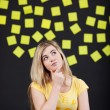 Teenage student thinks, sticky notes in the back — Stockfoto