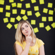 Teenage student thinks, sticky notes in the back — Foto de Stock