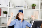 Businesswoman rejoicing in her office — Stock Photo