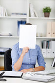 Businesswoman holding a blank white sign — Stock Photo