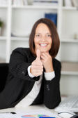 Confident Businesswoman Gesturing Thumbsup Sign At Desk — Stock Photo