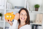 Whispering piggybank — Stock Photo