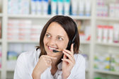 Businesswoman Conversing On Headset In Pharmacy — Stock Photo