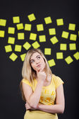 Teenage student thinks, sticky notes in the back — Stock Photo
