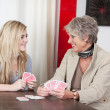 Grandmother playing cards with her granddaughter — Stock Photo