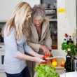Grandmother and her granddaughter in the kitchen — Stock Photo