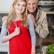 Grandmother and granddaughter posing in kitchen — Stock Photo #27360419