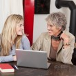 Stock Photo: Grandmother and granddaughter working together