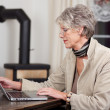 Female Pensioner Using Laptop At Home — Stock Photo