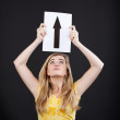 Teenage Girl Holding Up Arrow Sign Over Head — Stock Photo