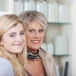 Teenage Girl With Grandmother Smiling — Stock Photo #27361251