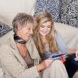 Grandma And Granddaughter Looking At Photos — Stock Photo