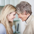 Happy Teenage Girl And Grandmother Looking At Each Other — Stock Photo