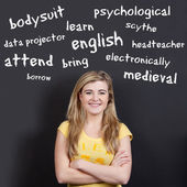 Confident Smiling Teenage Girl Against English Vocabulary — Stock Photo
