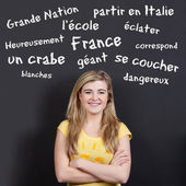 Confident Smiling Teenage Girl Against French Vocabulary — Stock Photo
