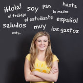 Confident Smiling Teenage Girl Against Spanish Vocabulary — Stock Photo