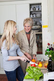 Grandma And Granddaughter Cutting Vegetables — Stock Photo