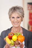 Smiling Older Woman With Fruits — Stock Photo