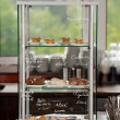 Delicious Food Displayed In Cabinet At Coffee Shop — Stok fotoğraf
