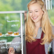 Waitress working in a cafe — Stock Photo