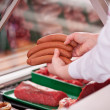 Stock Photo: Saleswomselling sausages