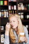 Beautiful woman enjoying latte macchiato — Stock Photo