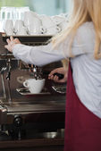 Waitress brewing a cup of coffee — Stock Photo