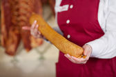 Midsection Of Butcher Holding Sausage — Stock Photo