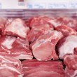 Fresh meat on display in a butchery — Stock Photo