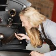 Barista checking quality of coffee beans — Stock Photo