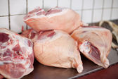 Pork legs lying in cold room at butcheries — Stock Photo