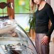 Woman looking at seafood in display cabinet — Stock Photo