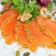 Slices of salmon with walnuts — Stock Photo