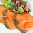 Fresh sliced salmon with herbs — Stock Photo