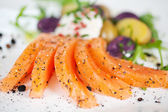 Salmon Slices Garnished With Pepper In Plate — Stock Photo