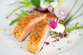 Garnished salmon fillet dish — Stock Photo